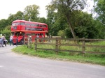 Visitors walk past a Routemaster bus on their way to and from the church.