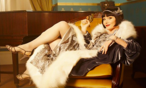 How could you not want to tune in? Essie Davis as Phryne Fisher (source )