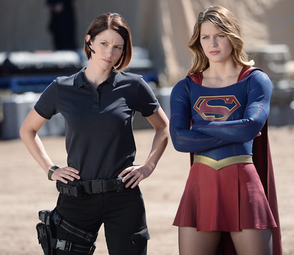 Alex Danvers (left, in case you didn't figure that out) with sis Supergirl (source)